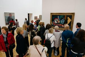 Gallery visitors listening to a guide explaining this still life by Pablo Picasso