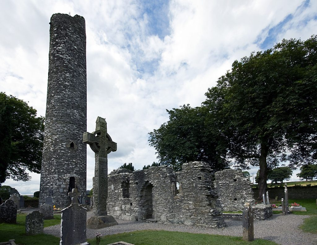 1200px-A_high_cross_and_round_tower_at_Monasterboice,_Ireland